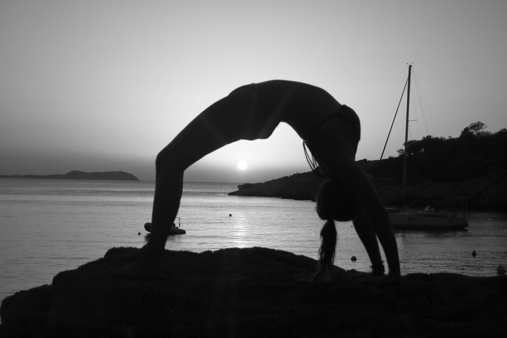 Lauri Berkhoudt wheel pose black and white, yoga retreat Ibiza
